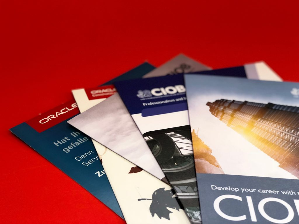 a picture of a selection of brochures for different companies